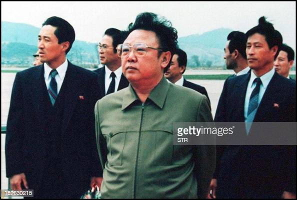 Photo dated 17 April 1992 shows North Korean leader Kim JongIl on the tarmac at Pyongyang Airport following a visit by then Chinese President Yang...