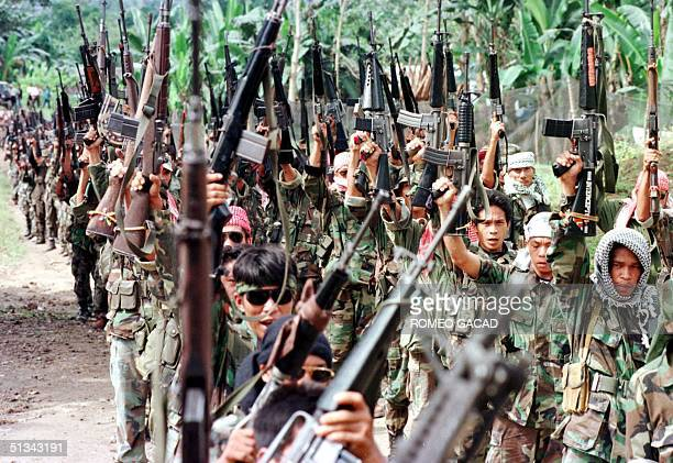 Photo dated 27 February 1999 shows some 700 fully armed secessionist Moslem rebels of the Moro Islamic Liberation Front brandish their weapons during...