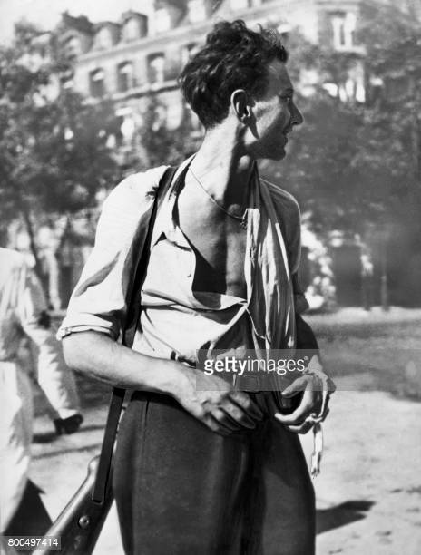Photo dated between 22 and 24 August 1944 of an armed Parisian taking part of the Liberation of Paris PHOTO /
