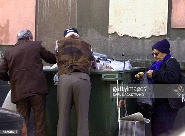 Photo dated early December 1999 shows elderly Israelis in search for food in the garbage bins of a Tel Aviv supermarket According to a report by the...
