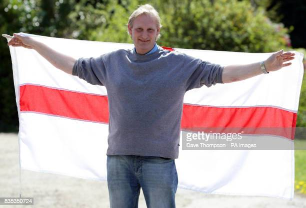 STANDALONE photo Director Mike Grundy holds a St George's flag at United Flags and Flagstaffs in Middleton Manchester before the St George's day...