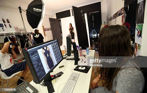 A photo editor watches as a model poses during a photo shoot at the headquarters of Asos Plc in London UK on Wednesday July 17 2013 Asos Plc the UK's...