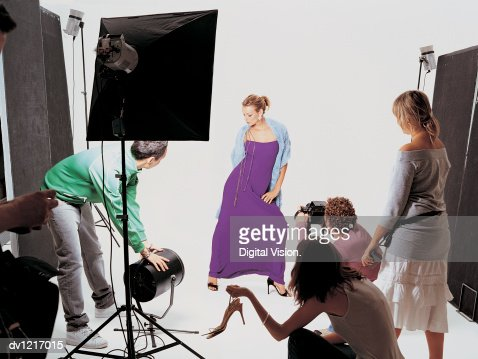 Photo Fashion Shoot With Model Posing, Photographer and People Watching : Stock Photo