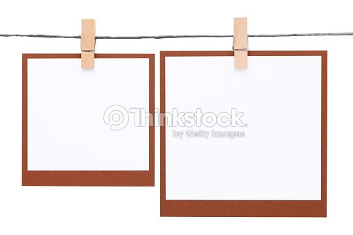 Photo Frame Hung On Rope With Clothespin Stock Photo | Thinkstock