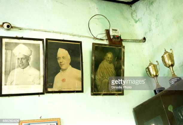 Photo frame of political leaders in school room in Ngo Patang, Sambalpur, Orissa, India.