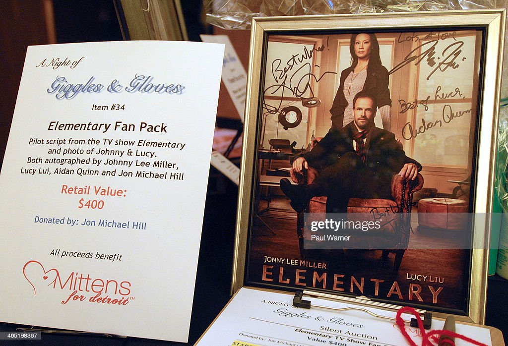 A photo from the television show 'Elementary' signed by Lucy Lui, Johnny Lee Miller, Aidan Quinn and Jon Michael Hill is seen during a silent auction at attends Mittens for Detroit's 4th annual night of Giggles and Gloves> at MGM Grand Hotel on January 25, 2014 in Detroit, Michigan.