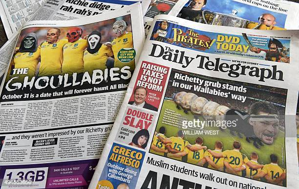 A photo illustration shows a selection of Australian newspapers displayed in Sydney on October 28 showing support for the nation's rugby World Cup...