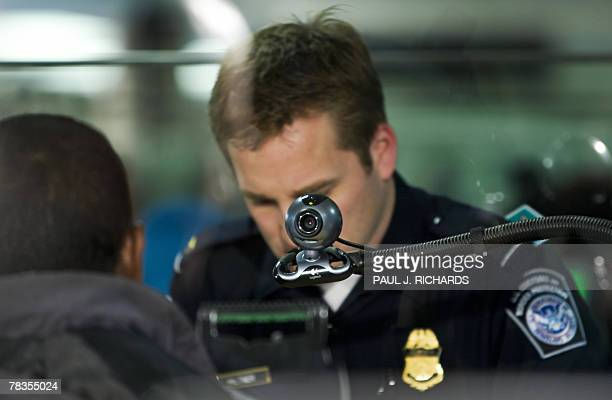 A photo is taken by the Department of Homeland Security as well as a 10fingerprint scanner for international arriving passengers 10 December 2007 at...