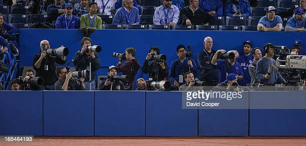 Photo Journalist look indifferent directions late in the game as the Toronto Blue Jays lost their home opener 41 to the Cleveland Indians at The...