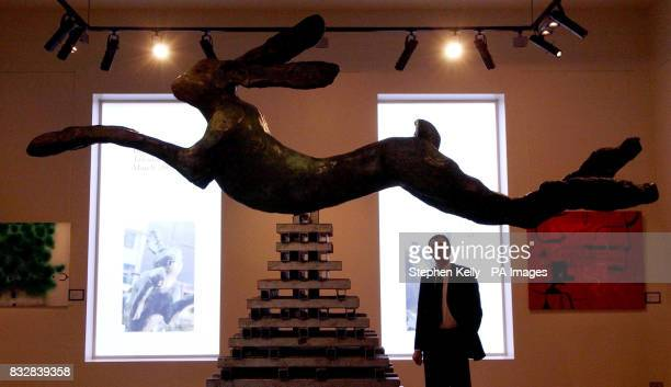 Photo Julian Roup the director of press and marketing at Bonhams auction house London views a bronze on steel sculpture by Barry Flanagan portraying...