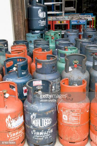 MYANMAR DOMESTIC GAS BOTTLES IN A SHOP IN MANDALAY Photo © Julio Etchart CDREF00779