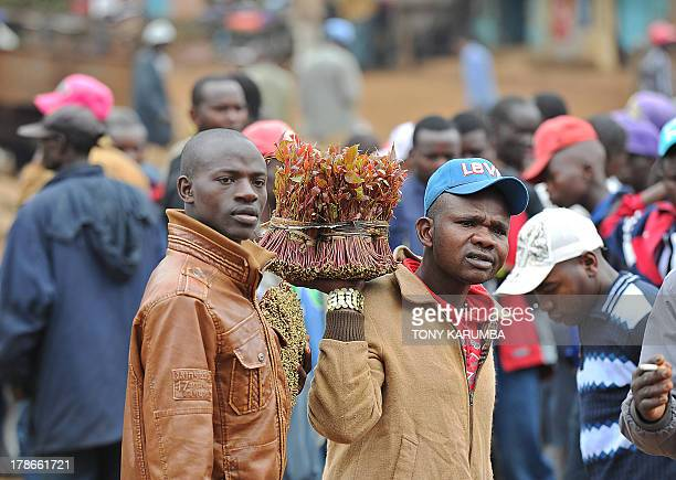 Photo made July 29 2013 shows a trader hawking khat parcels at a local market in Kenya's misty central highlands region of Meru Khat called miraa in...