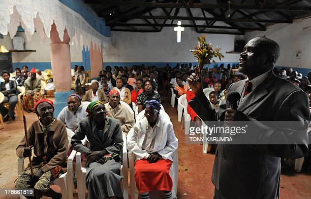 Photo made July 29 2013 shows Pator John Maroo praying over khat given as offering by members of his congregation at the East Africa Pentecostal...