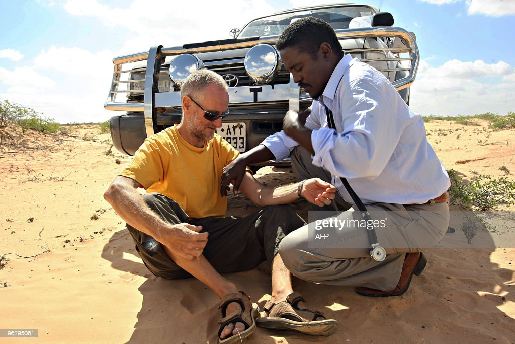 A photo made on January 28 2010 shows Briton Paul Chandler being examined by Somali doctor Abdi Mohamed Helmi 'Hangul' at a location in central...