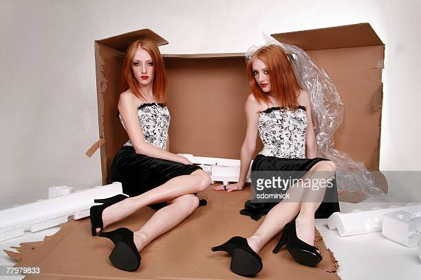 A photo montage of a beautiful fashion model sitting in an open product box.