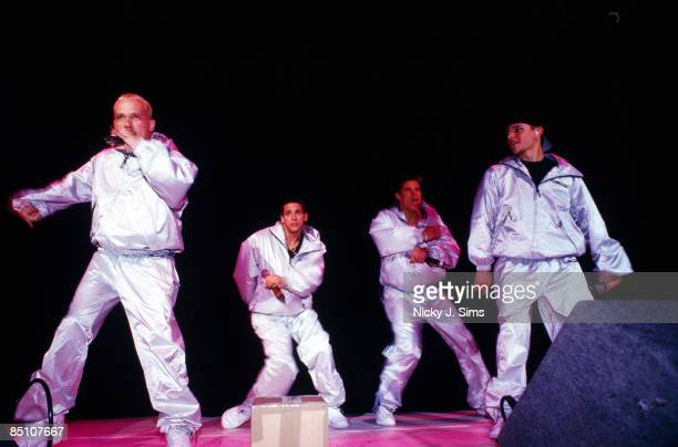FORUM Photo of 98 DEGREES and 98o and Justin JEFFRE and Drew LACHEY and Jeff TIMMONS and Nick LACHEY Group performing on stage LR Justin Jeffre Drew...