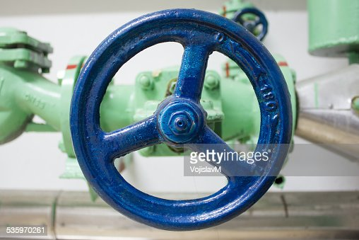 Photo of a blue valve close up : Stock Photo