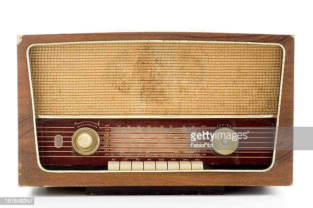 Photo of a brown vintage radio with wooden casing