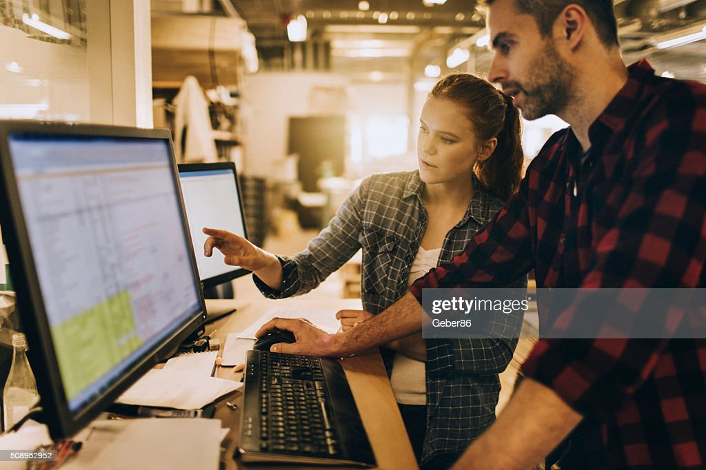 Photo of a coworkers in printing factory : Stock Photo