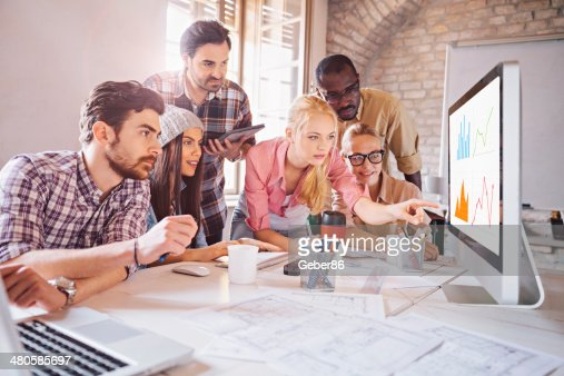 Photo of a designer team working on a project