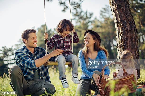 Photo of a family having picnic in the forest