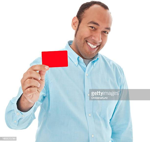Photo of a friendly mixed race man holding a red credit card