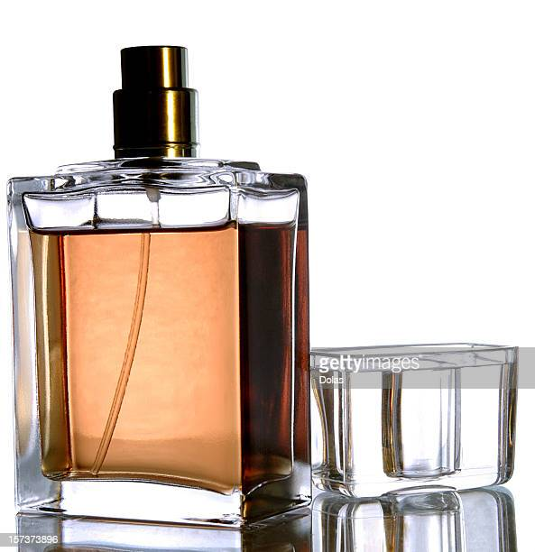 Photo of a glass perfume spray bottle with the lid removed