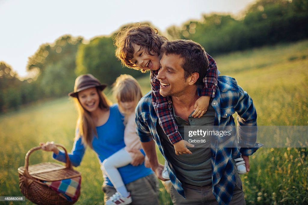 Photo of a happy family going for picnic : Stock Photo