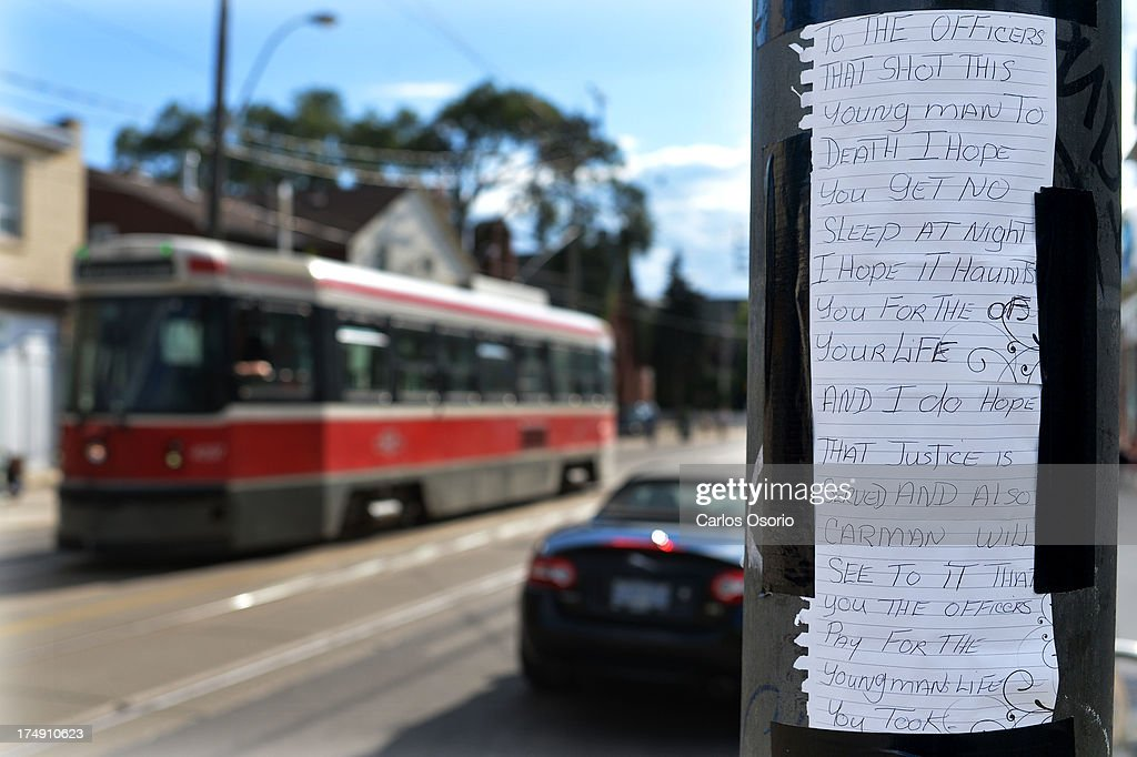 TORONTO, ON - JULY 28 - Photo of a memorial set up at the scene of Saturday's deadly shooting on a TTC streetcar at the intersection of Dundas Street West and Bellwoods Avenue. Family and friends of Sammy Yatim, 18, are devastated and seeking answers after the teenager was shot and killed by police on a Dundas streetcar early Saturday. His distraught father said he was an 'ordinary kid' and neighbours were brought to tears by the news. But a close friend said that Sammy had changed in recent months. July 28, 2013. Carlos Osorio/Toronto Star