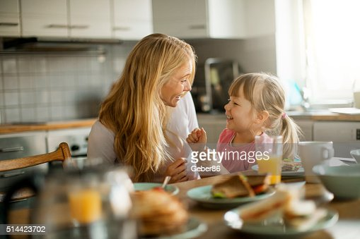 Photo of a mother and daughter having breakfast