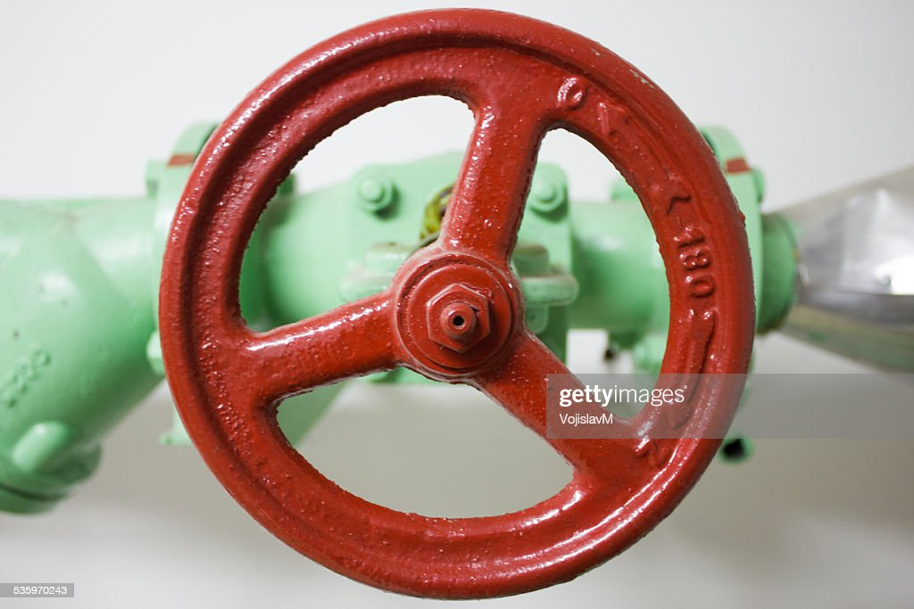 Photo of a red valve close up front : Stock Photo