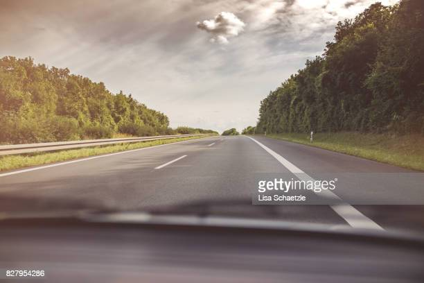 Photo of a road taken out of a car