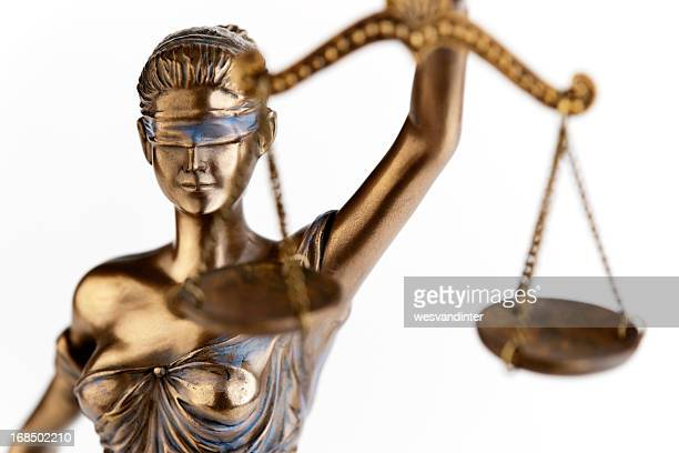 Photo of a statue of Themis, blindfolded justice with scales