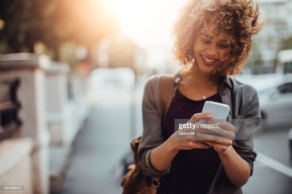 Photo of a woman using smart phone : Stock Photo