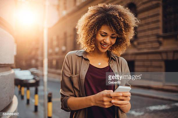 Photo of a woman using smart phone