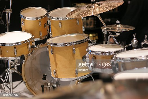 Photo of a yellow drum set on black