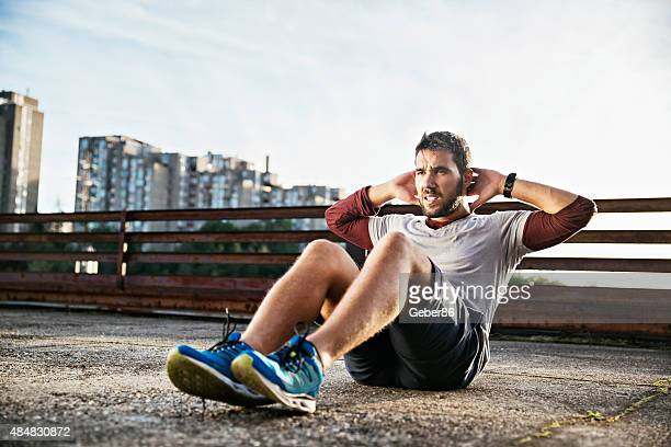 Photo of a young athletic man exercising outdoors
