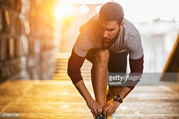 Photo of a young athletic man getting ready