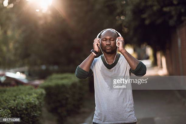 Photo of a young athletic man listening to music