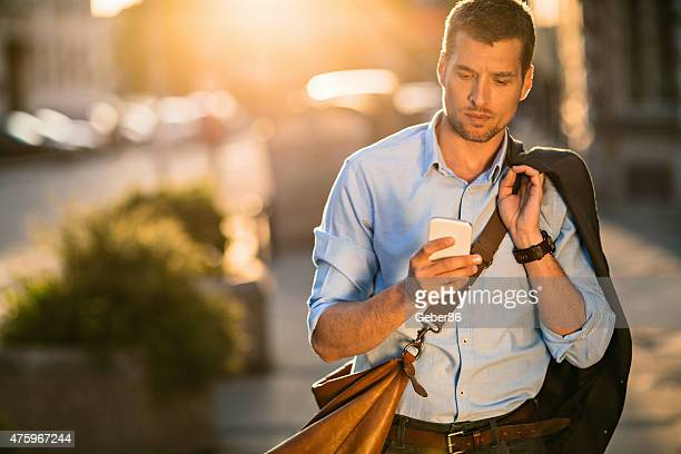 Photo of a young businessman using smart phone