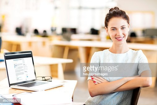 Photo of a young businesswoman sitting and smiling