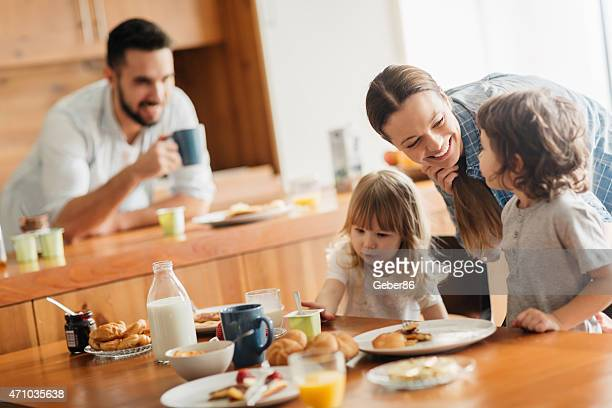 Photo of a young family having breakfast together
