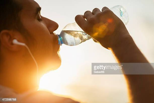 Photo of a young man drinking water
