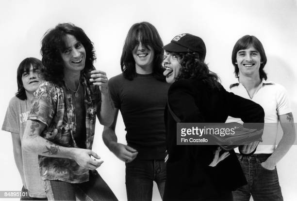 CAMDEN Photo of AC DC and AC/DC and Angus YOUNG and Bon SCOTT and Malcolm YOUNG and Phil RUDD and Cliff WILLIAMS Posed studio group portrait LR...