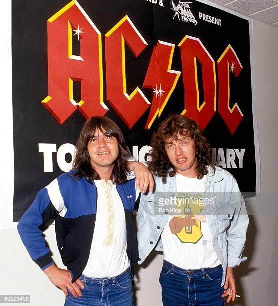 Photo of AC DC and Malcolm YOUNG and Angus YOUNG and AC/DC Malcolm Young and Angus Young posed