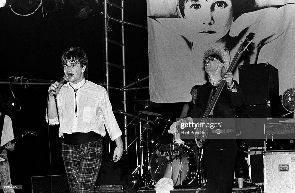 PALLADIUM Photo of Adam CLAYTON and BONO and U2, Bono (wearing tartan trousers) & Adam Clayton performing live onstage on Boy tour