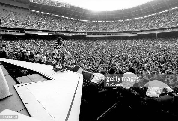 Photo of AEROSMITH and CROWDS performing live onstage in Washington stadium rock