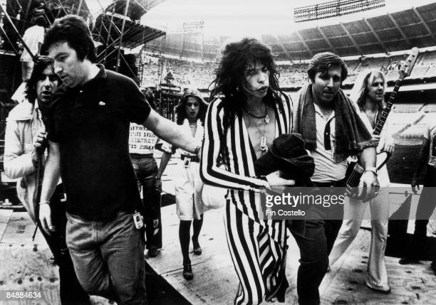 STADIUM Photo of AEROSMITH and Steven TYLER Steven Tyler walking from the stage with roadies