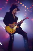 ARENA Photo of AEROSMITH Joe Perry performing live onstage playing Gibson Les Paul guitar