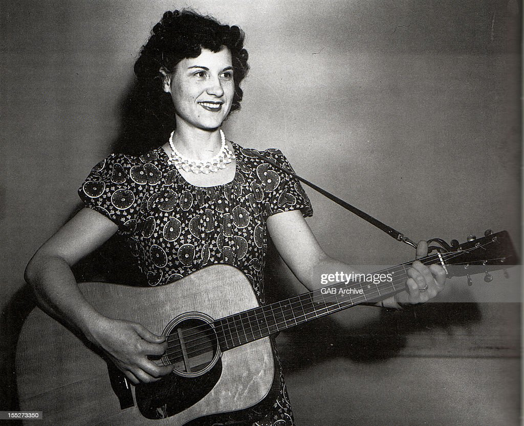 Photo of American country singer and guitarist Kitty Wells (1919-2012) posed with acoustic guitar circa 1950.